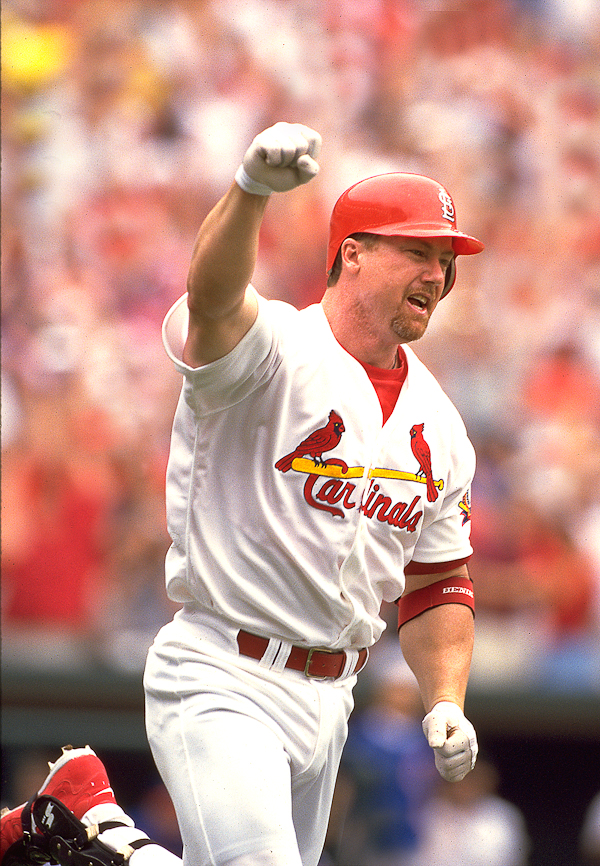 McGwire celebrating after home run No. 61.