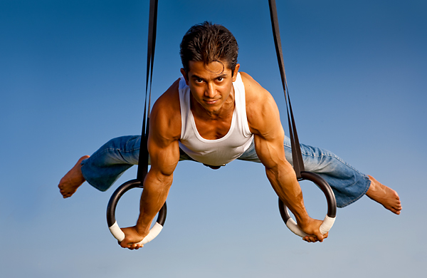 Olympic gymnast Raj Bhavsar hanging from a goalpost