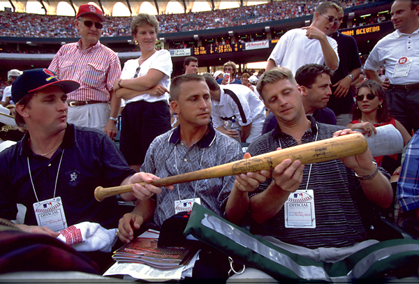 The sons of the late Roger Maris, checking out their father's 61st HR bat.
