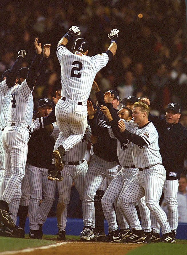 Derek Jeter jumps into the arms of his teammates after Game 4 of the 2001 World Series.