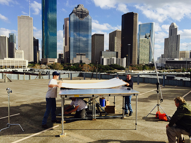 Our crew setting up the plexiglas stage on the rooftop parking garage.