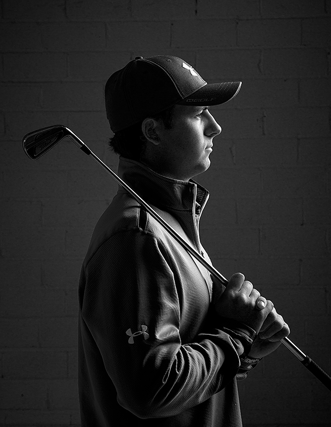 A black and white profile of jordan spieth during a studio shoot in dallas